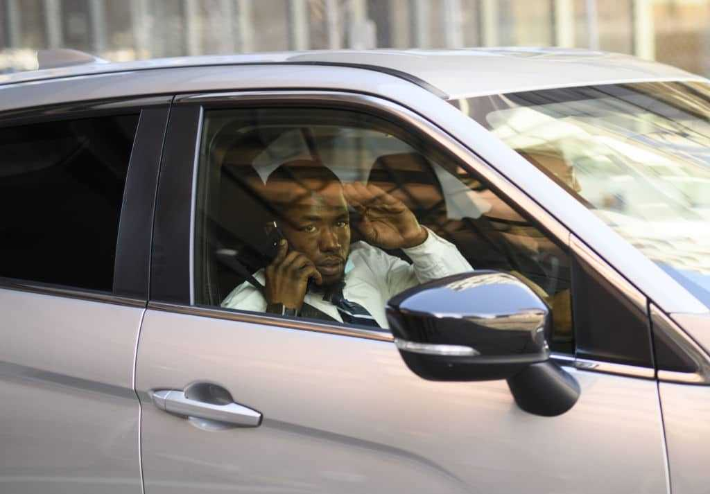Donald Williams, a trial witness, is seen in a car outside the Hennepin County Government Center on March 29, 2021